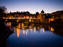 Night skyline of Rome. Scenic night view of Tiber river with illuminated skyline of Rome; dominated by Saint Peters Basilica, Italy stock photos
