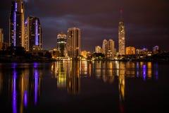 Night Skyline. Night time skyline reflecting off of water stock photos