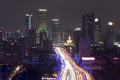 Night skyline view of Shanghai city and highways with car lamp t Stock Photography