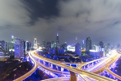 Night skyline view of Shanghai city and highways with car lamp t Stock Photo