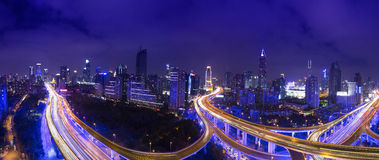 Night skyline view of Shanghai city and highways with car lamp t Royalty Free Stock Images