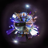 Night skyline of Warsaw. With soviet era Palace of Culture and science. 360 degree panoramic montage as tiny planet stock photo