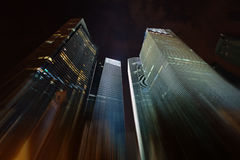 Night skyscrapers stretching into the sky Royalty Free Stock Photos