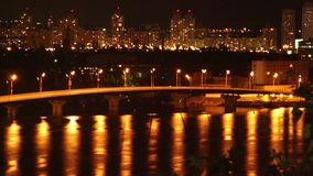 Night sleeping city cars drive on bridge yellow light reflection. Stock footage stock video footage
