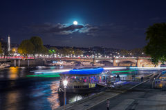Night slow motion view on river Seine in Paris Stock Image