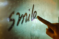 Night, the smile on the glass. Night, rain, smile write on glass Stock Photography