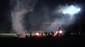 Night Smoke Production Setup. This video captures a nighttime production setup at a soccer field with rigs, lighting and smoke machines. This is a stock video stock video