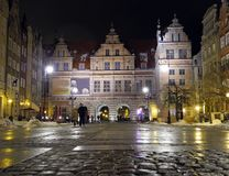 Night snapshot of central square in town of Gdansk. The snapshot of the house with passages on main square in town of Gdansk in winter time Royalty Free Stock Photos