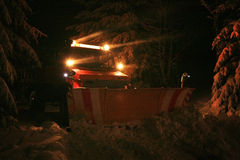 Night snow plow Stock Images