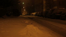 Night Snowed Street. Heavy snowfall in the neighborhood streets, late at night stock video footage