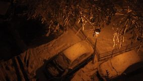 Night snowing  in parking stock video footage