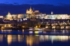 Night colorful snowy Christmas Prague Lesser Town with gothic Castle with Charles Bridge, Czech republic Royalty Free Stock Photography