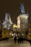Night snowy colorful  Prague Lesser Town with Bridge Tower and St. Nicholas` Cathedral from Charles Bridge, Czech republic Royalty Free Stock Images