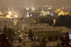 Night snowy foggy Prague City with St. Nicholas' Cathedral, Czech republic Royalty Free Stock Photo