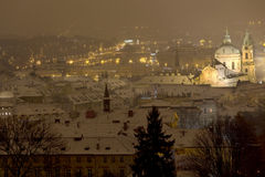 Night snowy foggy Prague City with St. Nicholas' Cathedral, Czech republic Stock Image