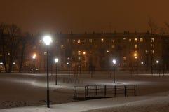 Night Snowy Park and Bridge. Scene with a lanterns Stock Photo