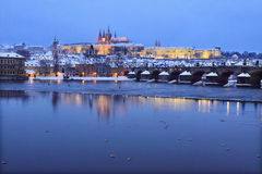 Night snowy Prague Castle with Charles Bridge Royalty Free Stock Photos