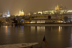 Night snowy Prague Lesser Town with gothic Castle, above River Vltava, Czech republic Royalty Free Stock Images