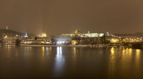 Night snowy Prague Lesser Town with gothic Castle, above River Vltava, Czech republic Stock Images