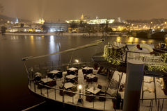 Night snowy Prague Lesser Town with gothic Castle, above River Vltava, Czech republic Stock Photo