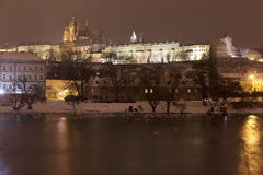 Night snowy Prague Lesser Town with gothic Castle, above River Vltava, Czech republic Royalty Free Stock Photos