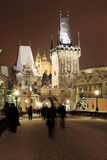 Night snowy Prague St. Nicholas' Cathedral from Charles Bridge Stock Image