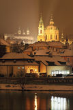 Night snowy Prague St. Nicholas' Cathedral Royalty Free Stock Image
