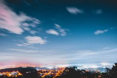 Night with some clouds and the city. Long exposure shoot at night with some clouds, stars and the city of Vinhedo in Brazil stock images