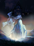 Night spectre. Ghost coming out of a tombstone, close to a frightening house Stock Photography