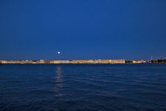 Night in St.Petersburg. Beautiful moon over Hermitage and embankment of River Neva Stock Image