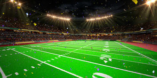Night stadium arena Football field championship win. Confetti and tinsel Stock Photos