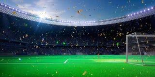 Night stadium arena soccer field championship win. blue toning. Night stadium arena soccer field championship win. Confetti and tinsel stock photography