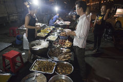 Night stall in Phnom Penh. Night stall with food on the street of Phnom Penh city in Cambodia Stock Photo