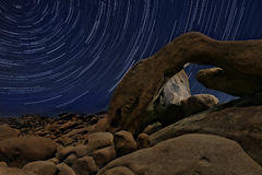 Night Star Trail Streaks over the Rocks of Joshua Tree Park Royalty Free Stock Image