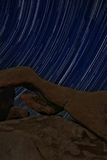Night Star Trail Streaks over the Rocks of Joshua Tree Park Stock Photography