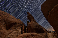 Night Star Trail Streaks over the Rocks of Joshua Tree Park Royalty Free Stock Images
