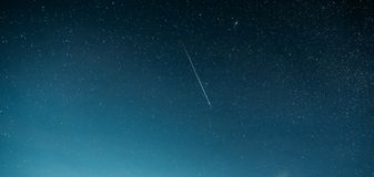 Night Starry Sky With Glowing Stars And Meteoric Track Trail. Meteorite Trail In Starry Sky Background stock image