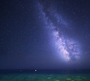 Night starry sky with Milky Way at the sea. Background Royalty Free Stock Images