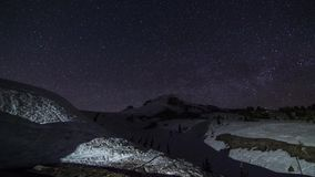 Night Stars at Mt. Hood with Snow Groomer at work stock footage
