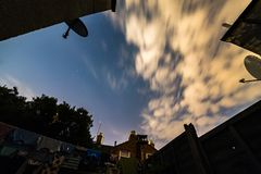 Night stars sky view from British backyard with laundry and satelite dishes around it stock photography