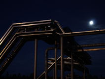 Night steel cable rack of low-voltage electrical. Power cables 10kV in the moonlight Royalty Free Stock Photos