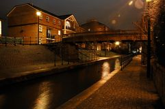 Night street. In Cardiff with brook, house, and bridge royalty free stock photography