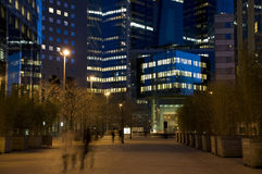 Night street. In the middle of the modern city with skyscrapers royalty free stock image