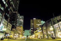 Night Street. Nighttime view of McGill College street, with lit buildings and skyscrapers royalty free stock photos