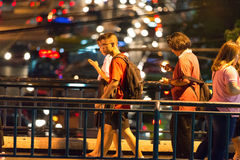 Night street. BANGKOK, THAILAND - AUGUST 24, 2016: Tourists and locals on the noisy and crowded night street in downtown of Bangkok Stock Photography