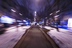 Evening street in the blur effect of the camera lens royalty free stock photos
