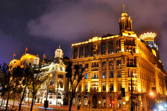 Night street and buildings of Shanghai Bund. Night view of China Shanghai Bund lighting buildings and street, shown as beautiful business city night landscape Stock Photo