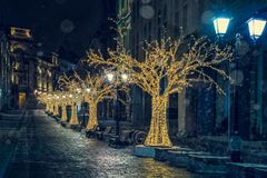 Night street with Christmas illumination and snow. Night street with Christmas illumination. Cold winter in Moscow Royalty Free Stock Image