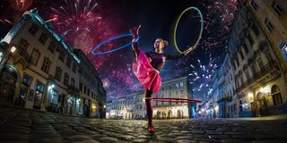 Night street circus performance whit clown, juggler. Festival city background. fireworks and Celebration atmosphere. Wide engle photo stock photo