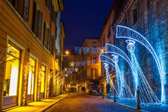 Night street decorated with lighting angels in Parma Stock Image